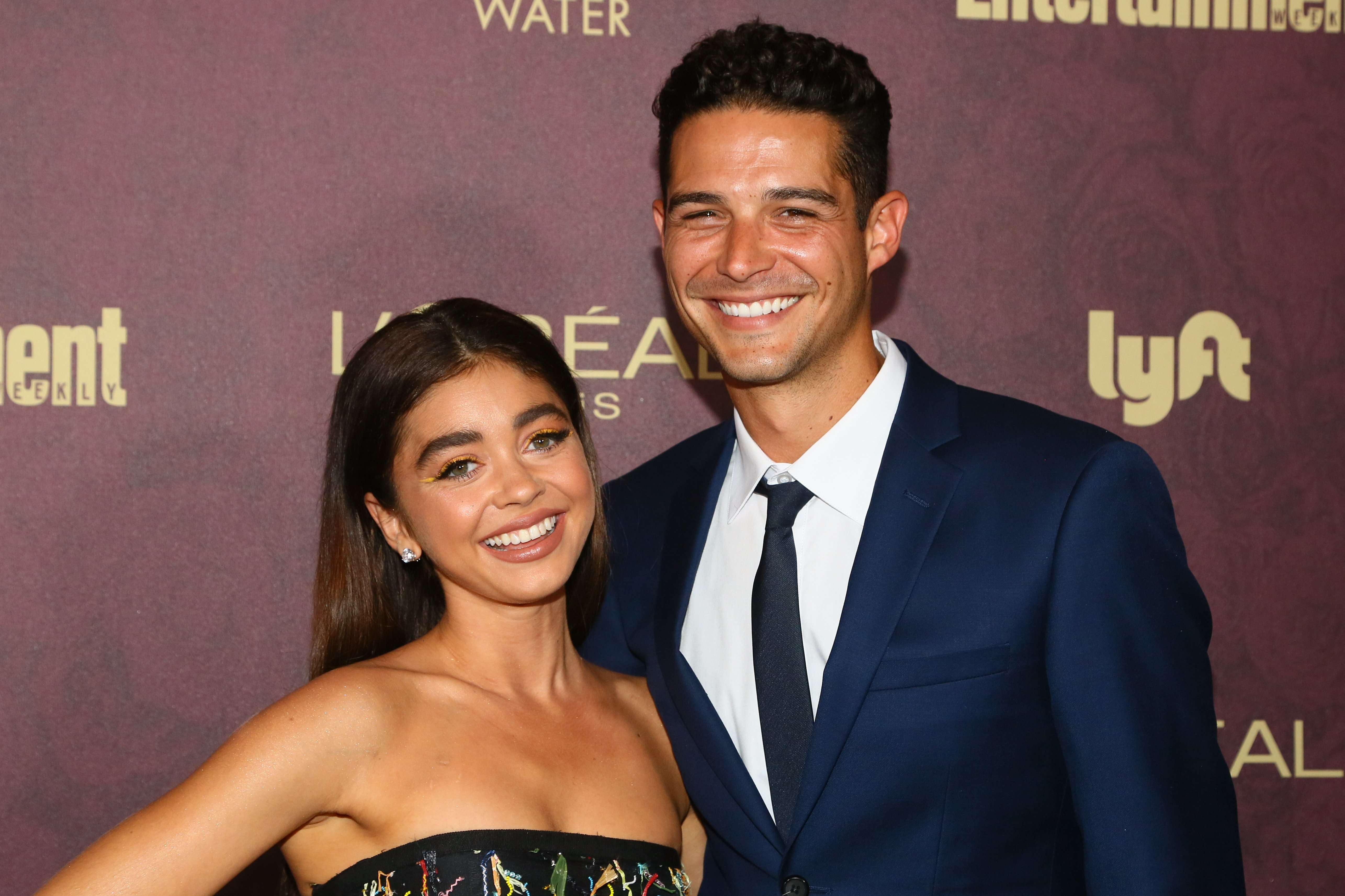 Sarah Hyland (L) and Wells Adams arrive to the 2018 Entertainment Weekly Pre-Emmy Party at Sunset Tower Hotel on September 15, 2018, in West Hollywood, California. | Source: Getty Images.