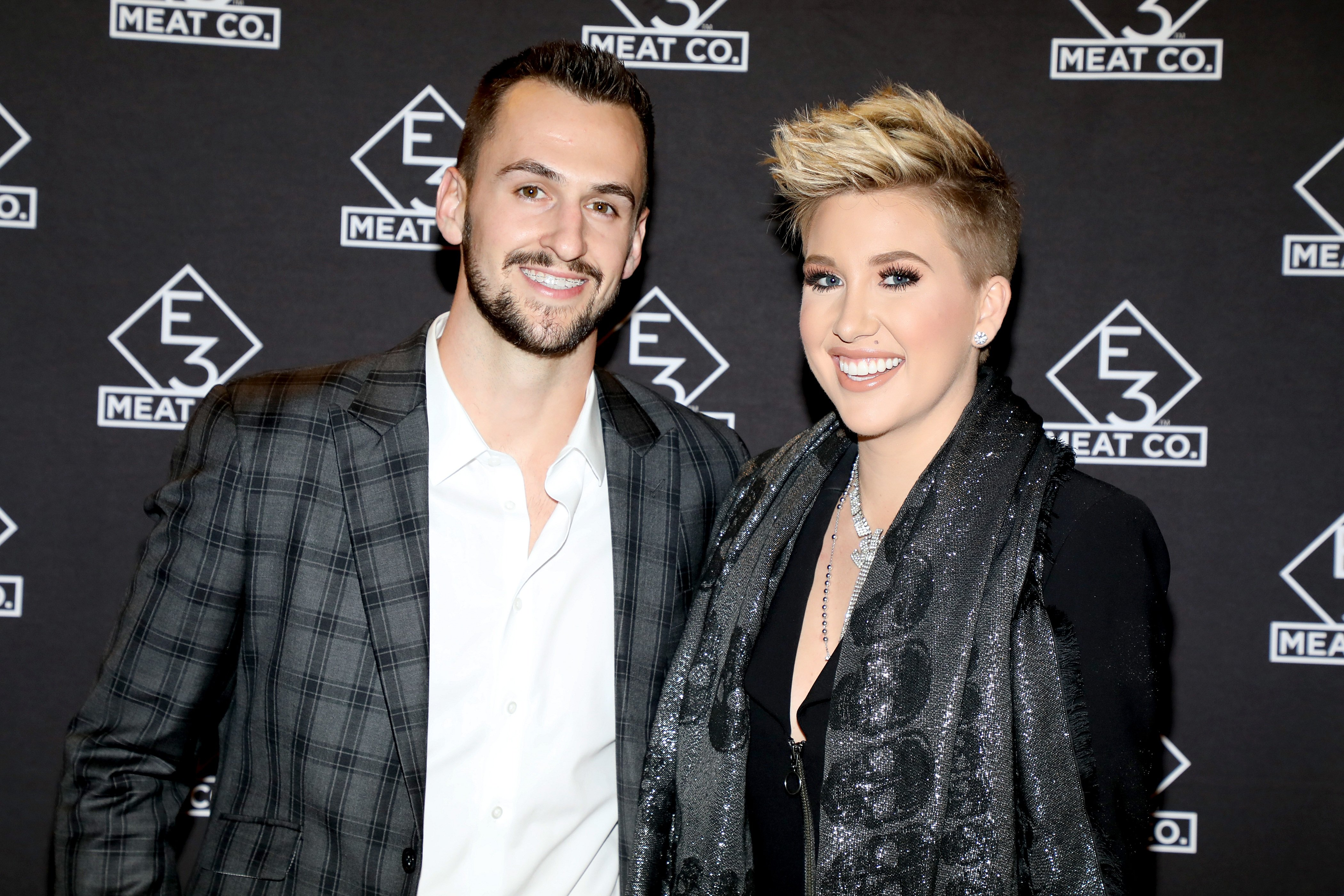 Nic Kerdiles and Savannah Chrisley attend the grand opening of E3 Chophouse Nashville on November 20, 2019. | Photo: Getty Images