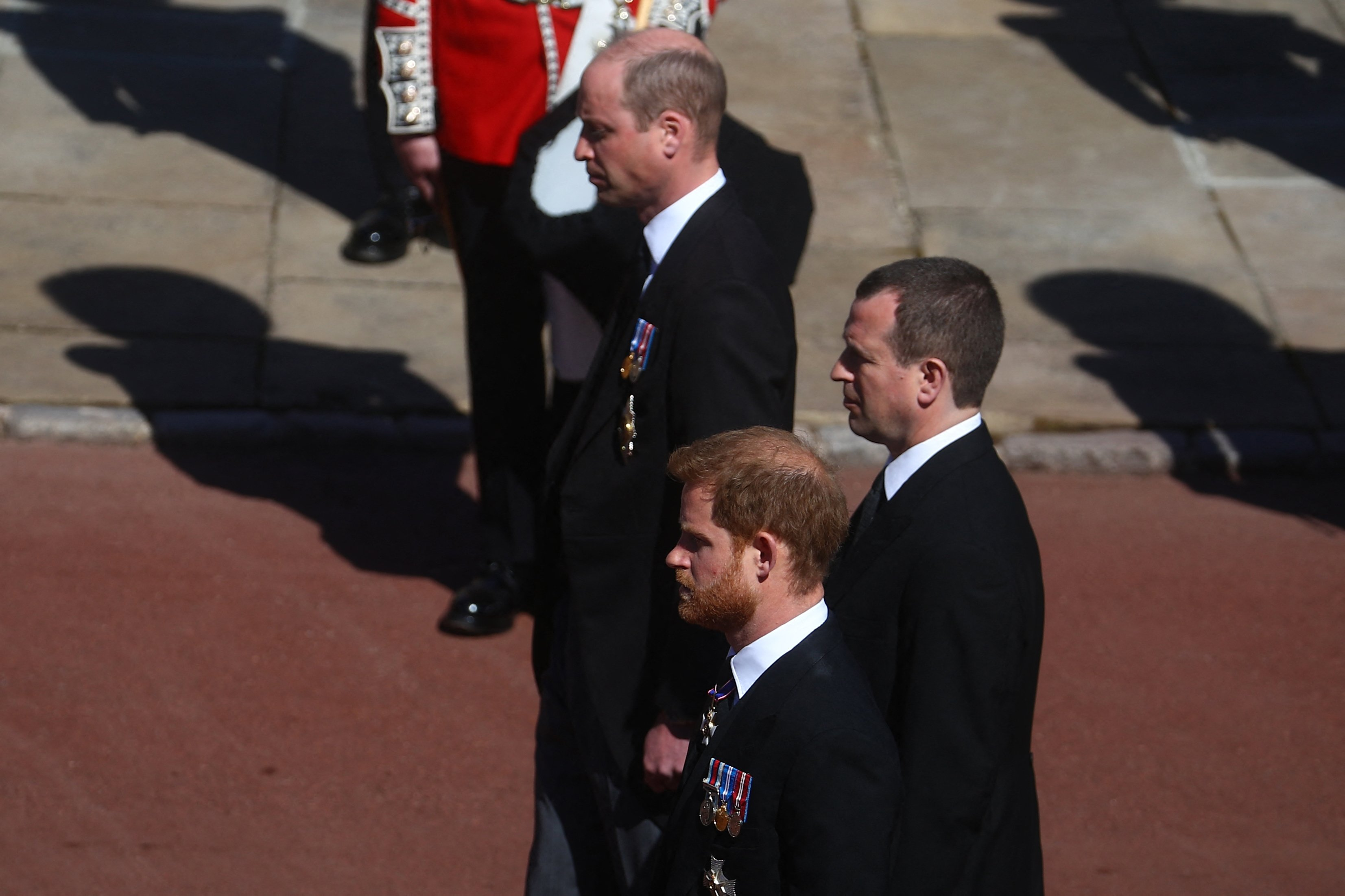 Prince William, Prince Harry and their cousin Peter Phillips follow the coffin of their grandfather, Prince Philip, the Duke of Edinburgh on April, 17, 2021