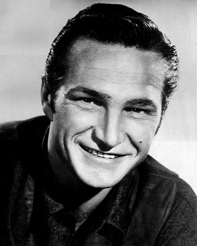 Eric Fleming in 1961. | Source: Wikimedia Commons.