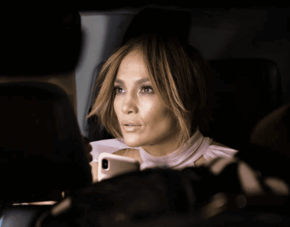 "Jennifer Lopez sitting in a car while filming on location for the movie ""Marry Me,"" on November 15, 2019 in New York City 