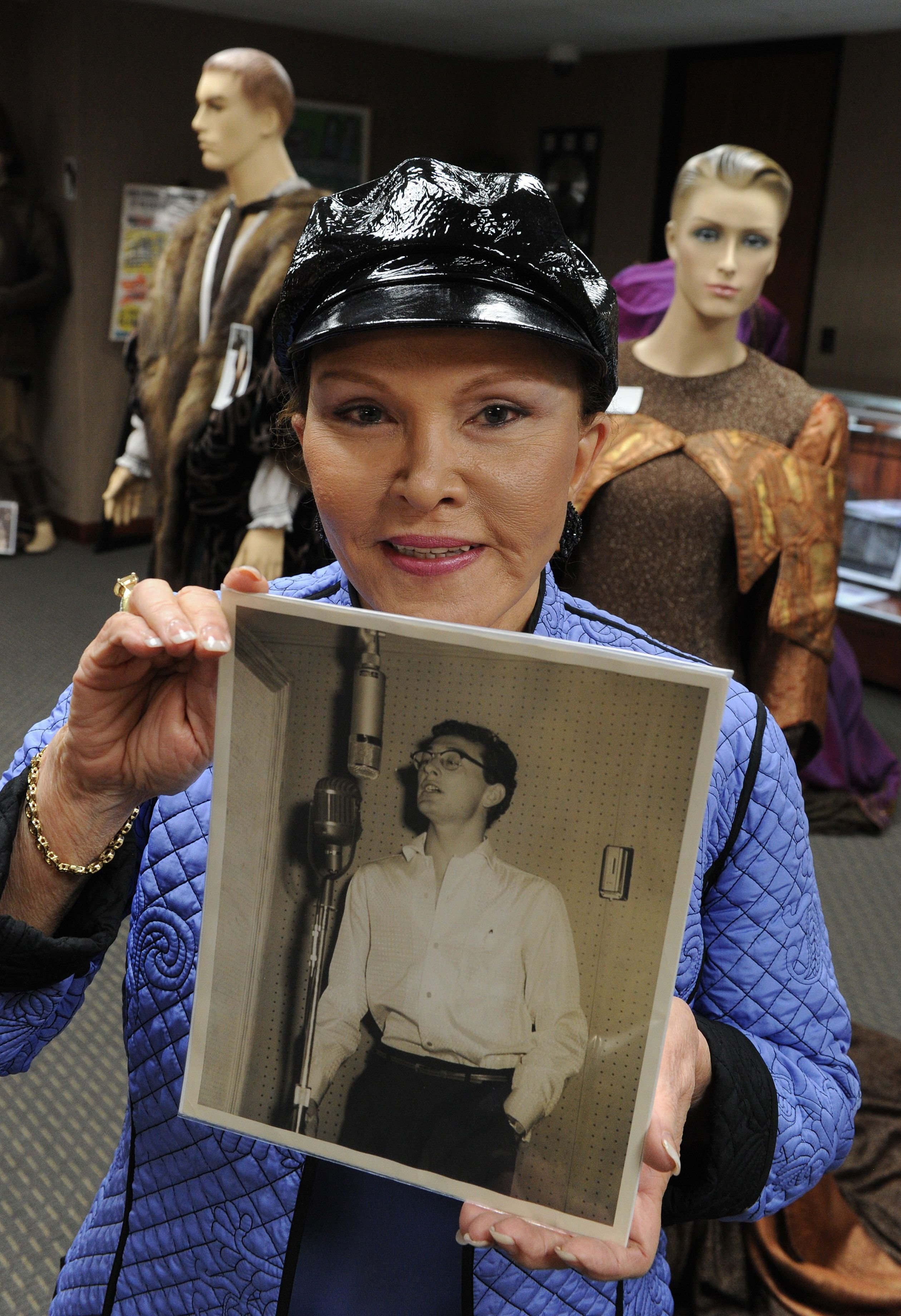 Maria Elena Holly holds a studio photo of Buddy Holly before an auction of the late singers memorabilia at the Heritage Auction Gallery in Beverly Hills on April 9, 2010.   Source: Getty Images