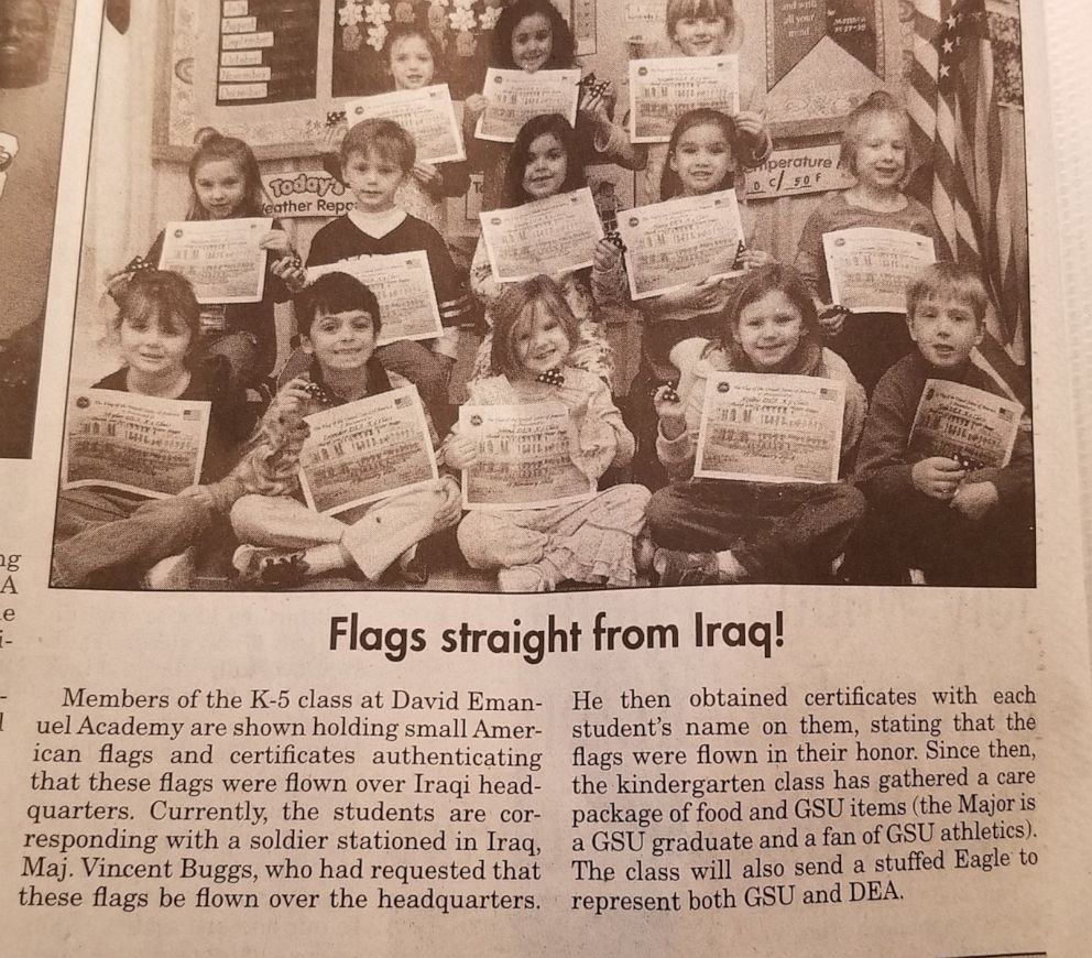 A photo of the David Emmanuel Academy kindergarten kids holding up their flags General Vincent Buggs gave them made it to their local newspaper. | Source: Facebook/davidemmanuelacademy|