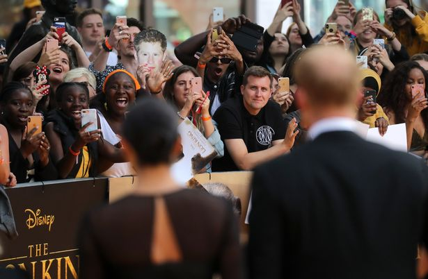 Fans reacting to seeing Duchess Meghan and Prince Harry at The Lion King premiere in London on July 14, 2019 | Photo: Getty Images