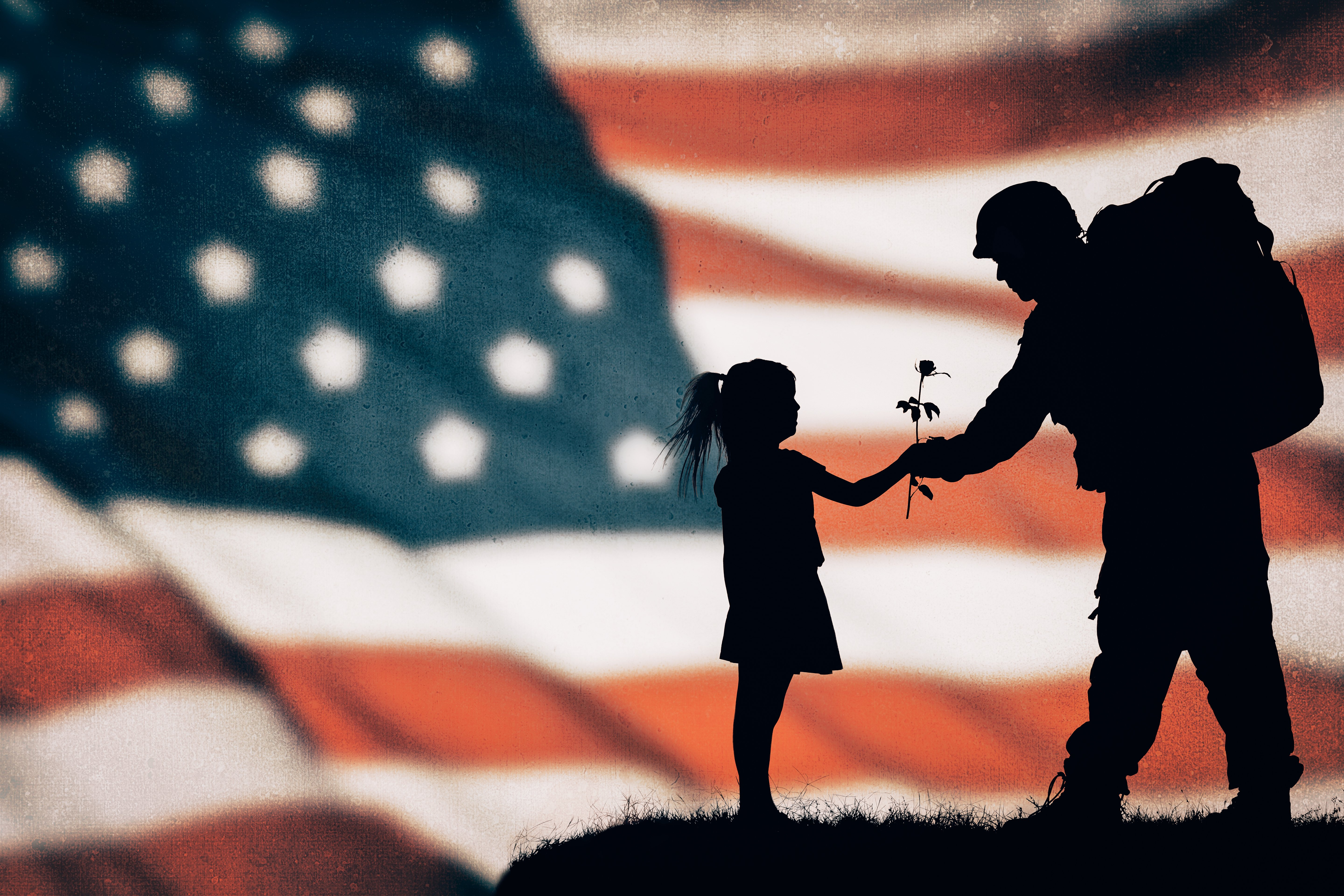 A little girl giving a rose to an American soldier | Photo: Shutterstock