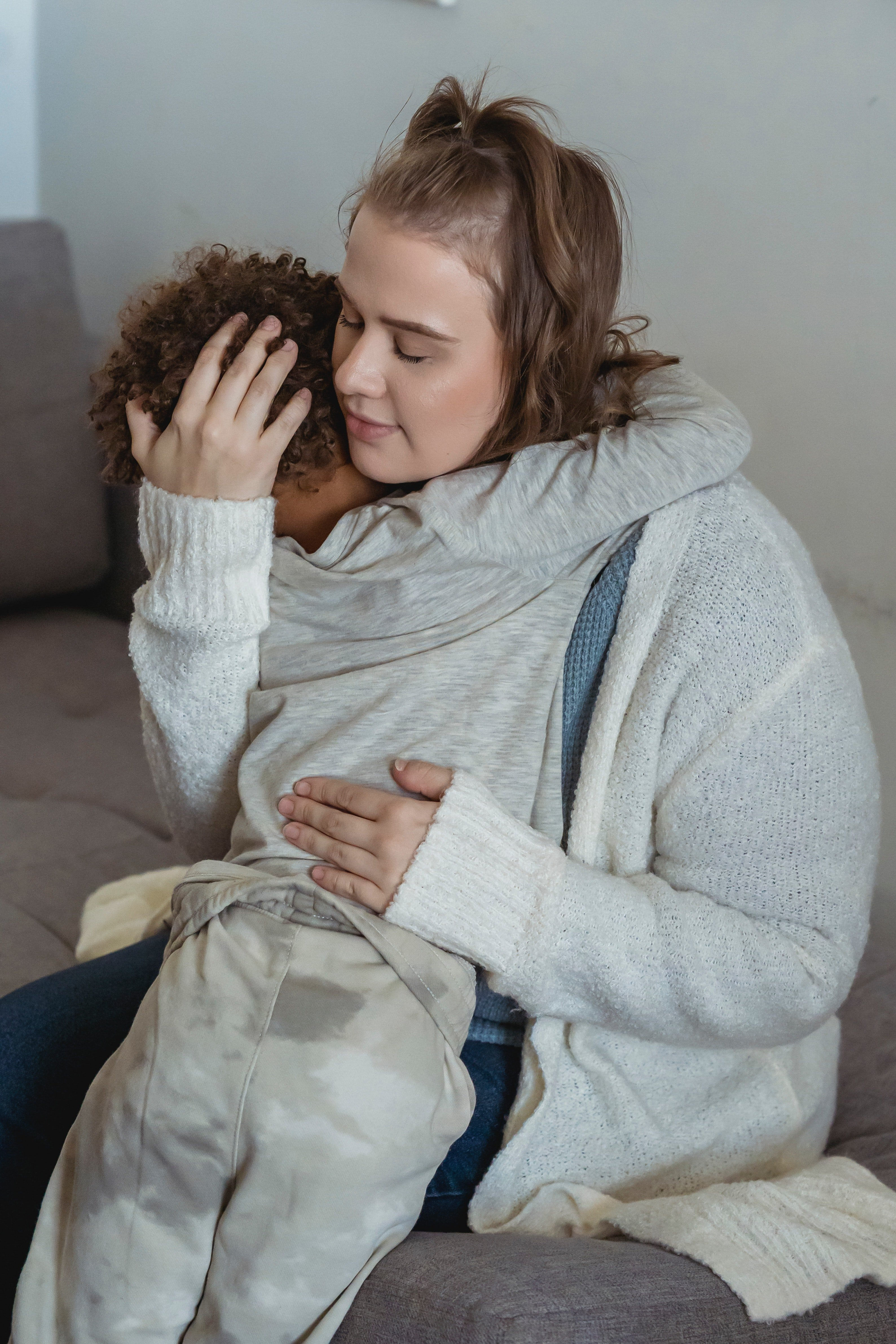 Mother comforts her son by hugging him   Photo: Pexels