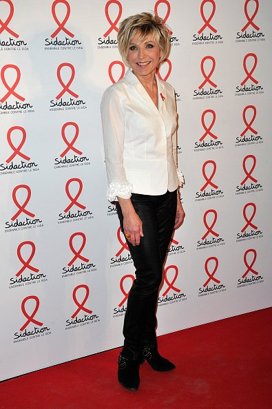 Evelyne Dheliat assiste à la soirée de lancement de Sidaction 2016 au musée du quai Branly le 7 mars 2016 à Paris. | Photo : Getty Images