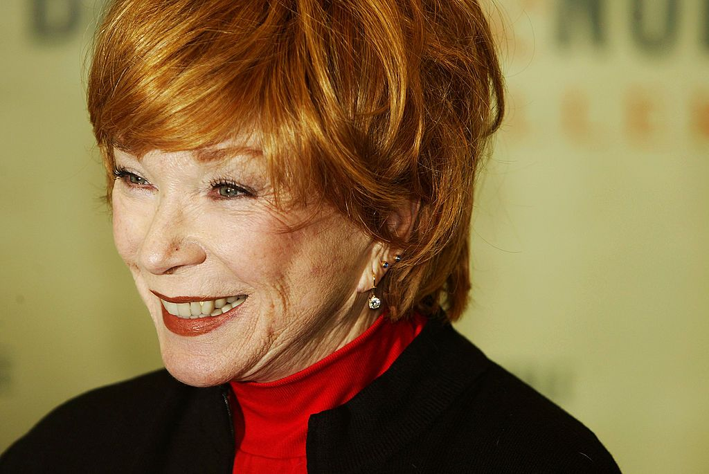 "Shirley Maclaine smiles at a signing for her new book ""Out on a Leash."" 