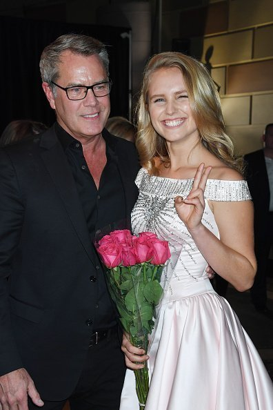 Architect Peter Cook (L) and model Sailor Brinkley-Cook pose backstage during the NYFW Sherri Hill Runway Show on February 9, 2018 in New York City | Photo: Getty Images