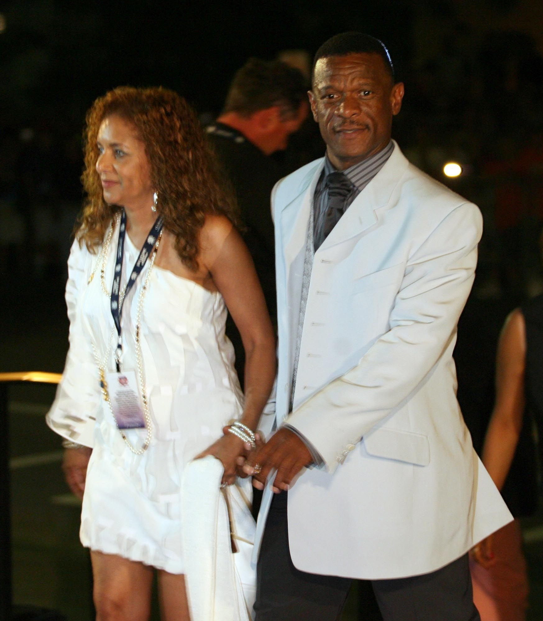 Rickey Henderson attending an event with his wife Pamela | Source: Getty Images