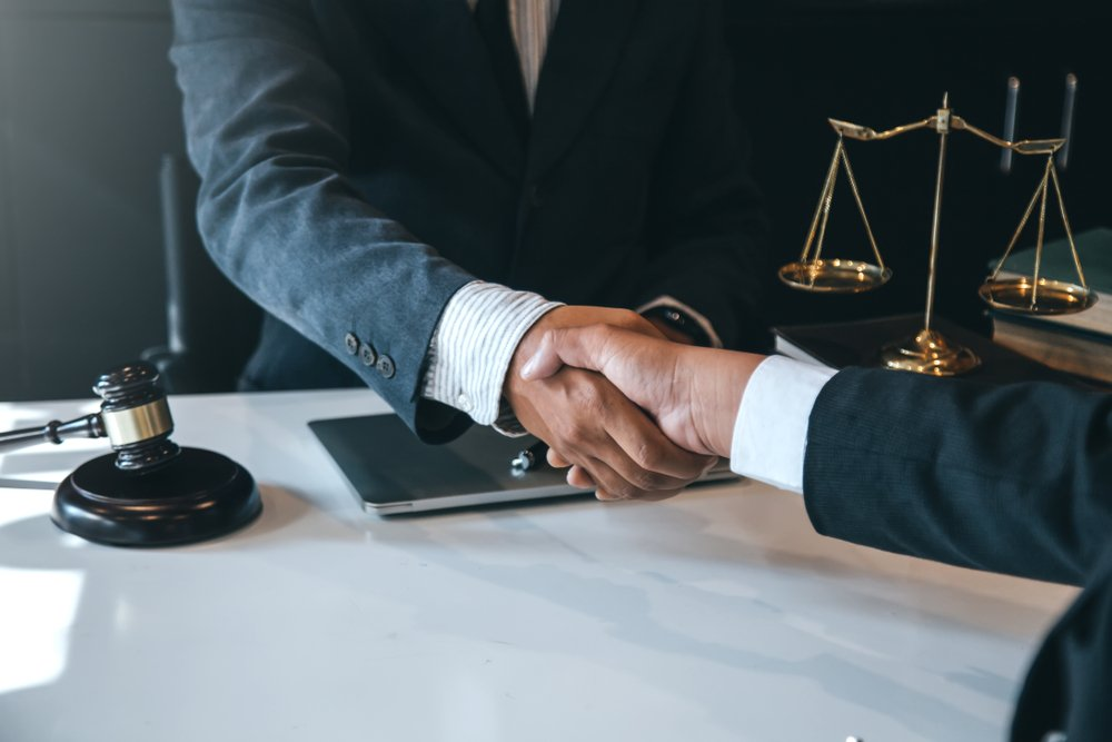 The attorney and client shaking hands to a settled case   Photo: Shutterstock
