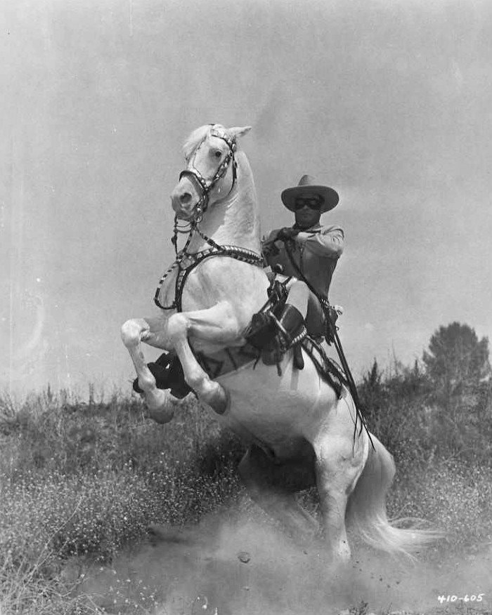 """Clayton Moore as the """"Lone Ranger"""" with his horse Silver in 1956.   Source: Wikimedia Commons."""