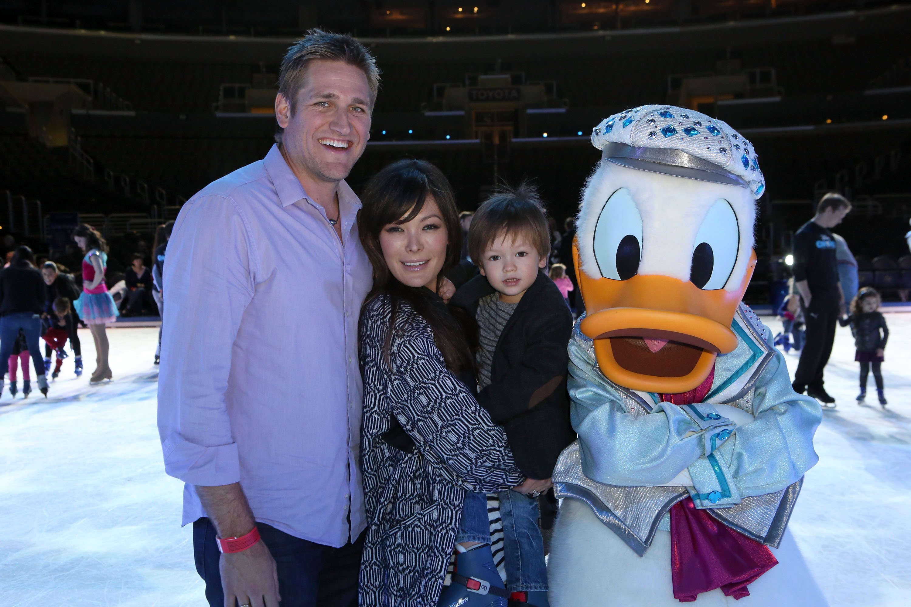 "Curtis Stone, Lindsay Price and their oldest son at ""Rockin' Ever After"" at Staples Center in 2013 