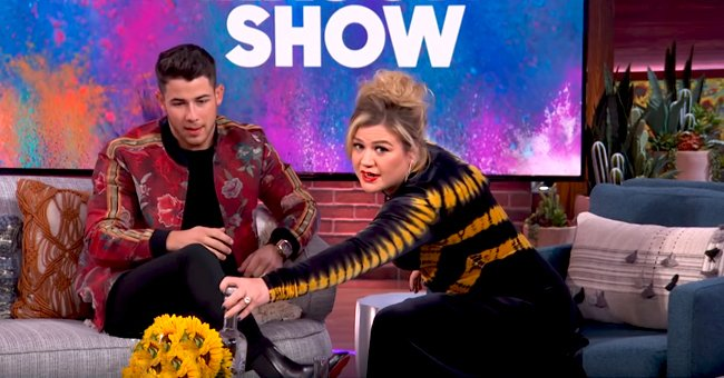 Kelly Clarkson Engages in Friendly Rivalry with Nick Jonas Ahead of His Coach Debut on 'The Voice'