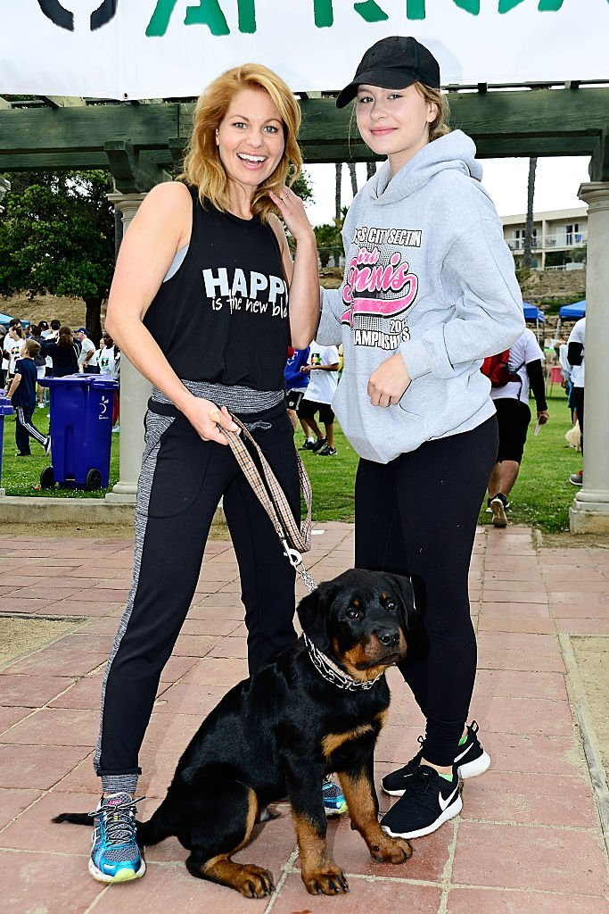 Candace Cameron-Bure, daughter Natasha and 4 month old puppy Boris attend the 7th Annual Walk To Africa  | Getty Images