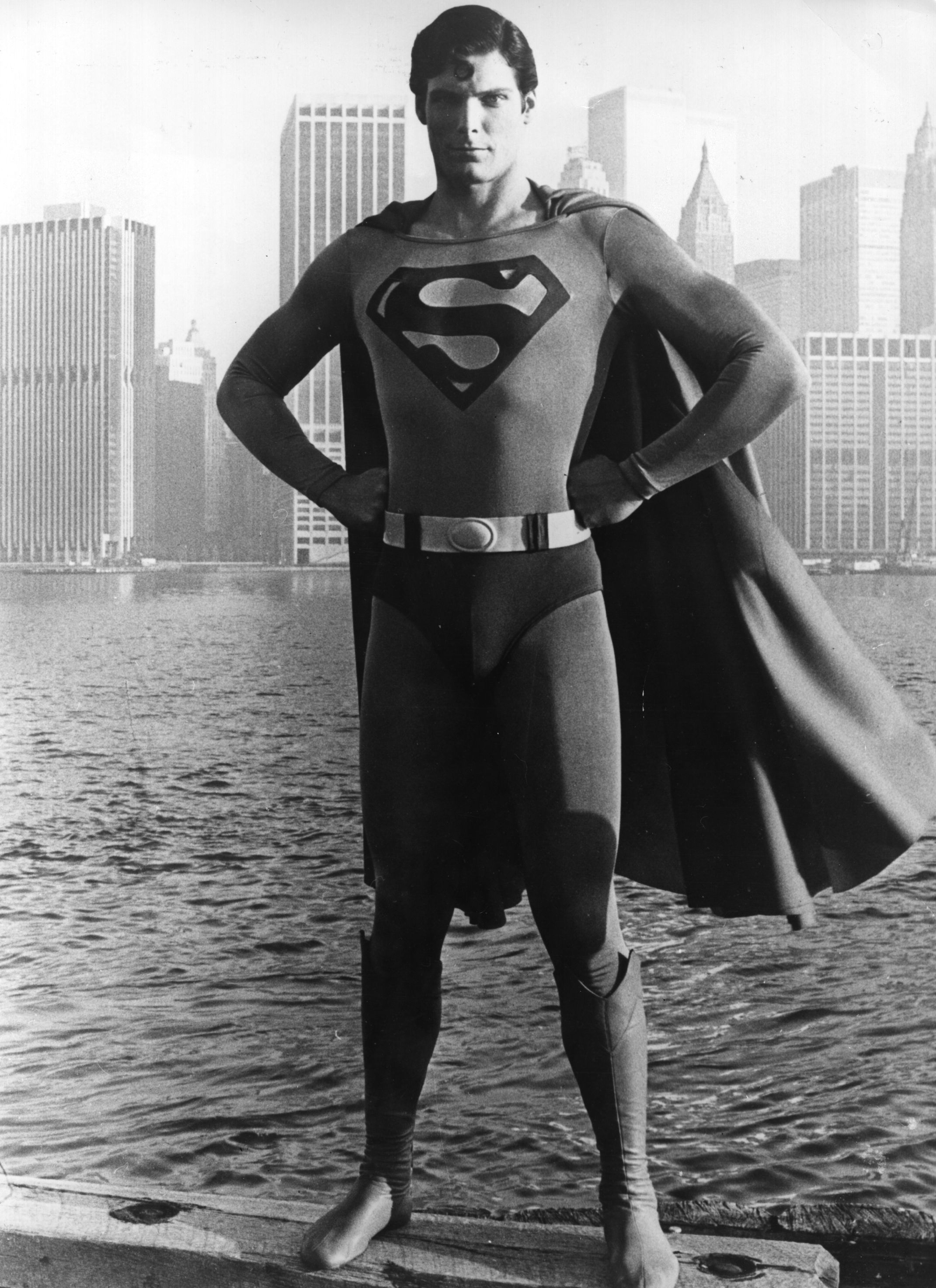 "Christopher Reeve stands in front of the Manhattan Skyline as ""Superman"" 