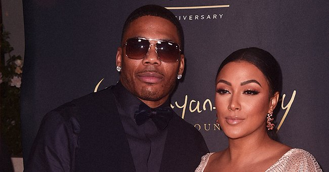 Nelly Posts Pic with Girlfriend Shantel Jackson Showing Major Leg and Deep Cleavage in a Sparkly White Dress