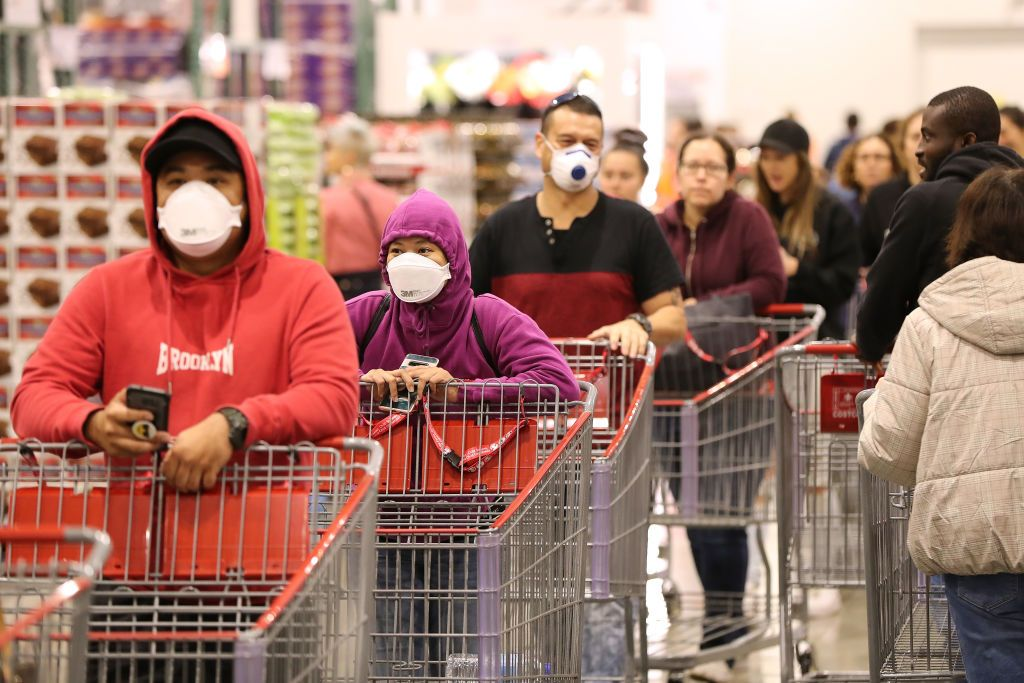 People are photographed social distancing while wearing face masks in a shopping mall due to the novel coronavirus on March 19, 2020 in Perth, Australia   Photo: Getty Images
