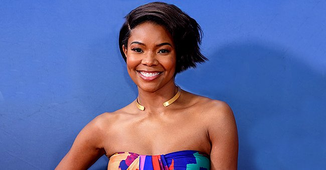 Gabrielle Union's Fans Are in Awe as She Poses in a Yellow Dress Detailed with Shoulder Bows