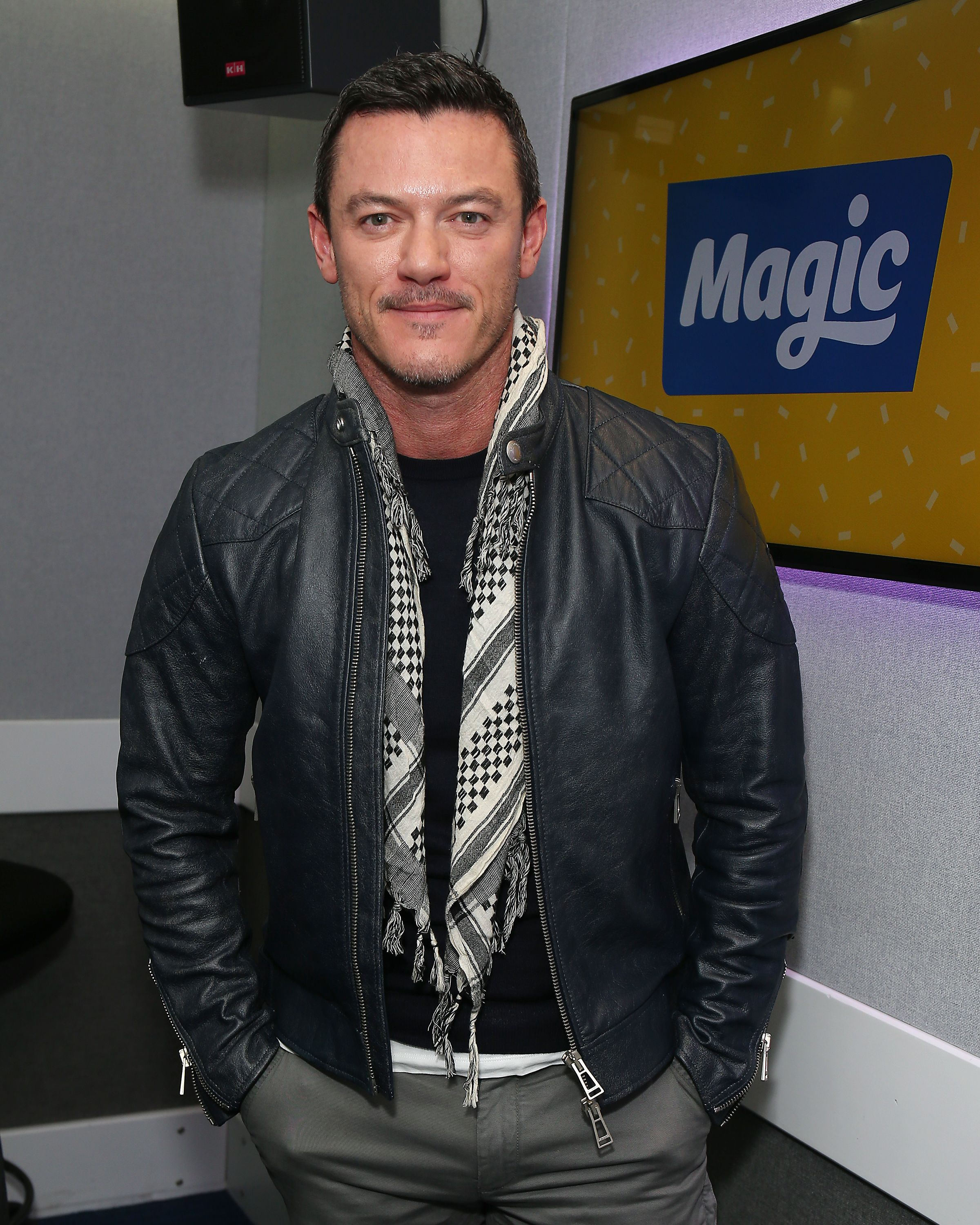 Luke Evans at Tom Price and Emma B at Magic Radio on March 28, 2018. | Photo: Getty Images