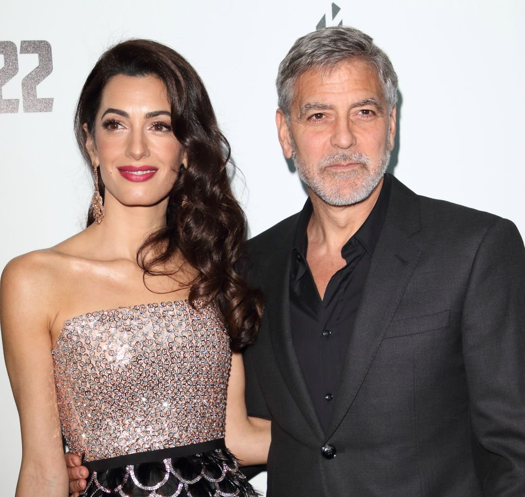 """Amal and George Clooney pictured at the """"Catch 22,"""" TV Series premiere at the Vue Westfield, 2019, London, England. 