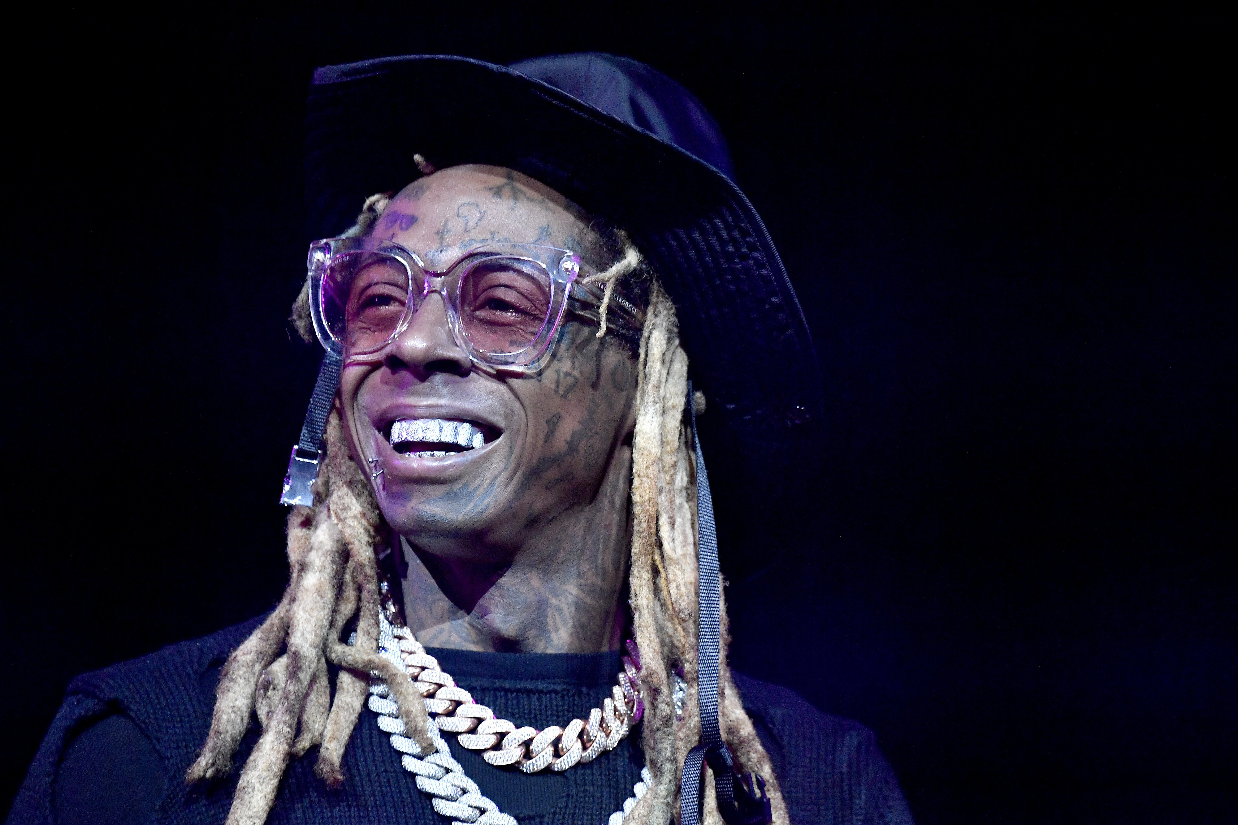 Lil Wayne on stage during the EA Sports Bowl at Bud Light Super Bowl Music Fest in Miami, Florida | Photo: Frazer Harrison/Getty Images for EA Sports Bowl