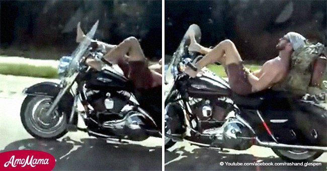 Fearless biker without shirt or helmet caught on video steering motorcycle with his feet