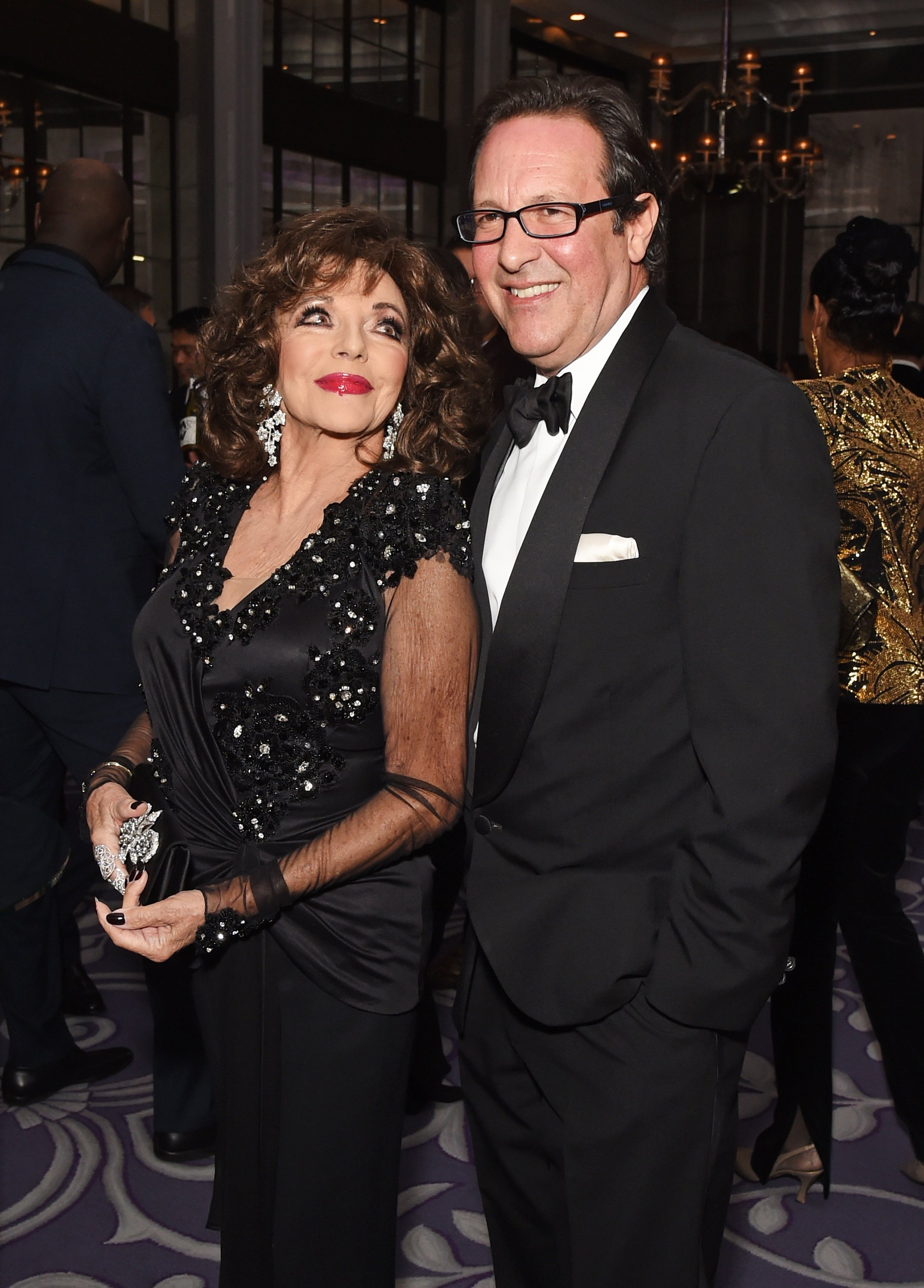 Joan Collins and Percy Gibson at the 8th Global Gift Gala London in aid of Great Ormond Street Hospital Children's Charity on November 18, 2017 | Source: Getty Images