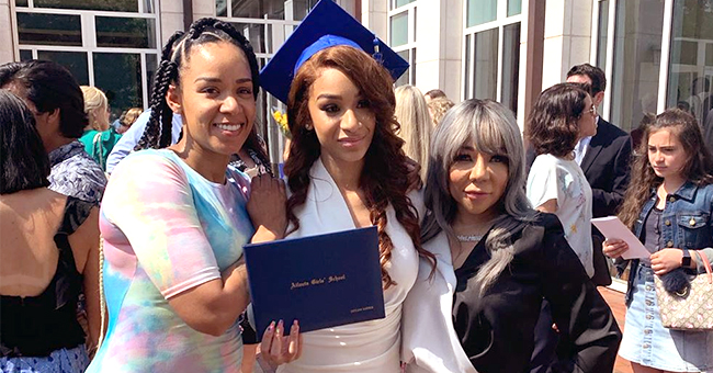 T.I.'s Daughter Deyjah Poses with Her 'Two Loving Mothers' at High School Graduation (Photo)
