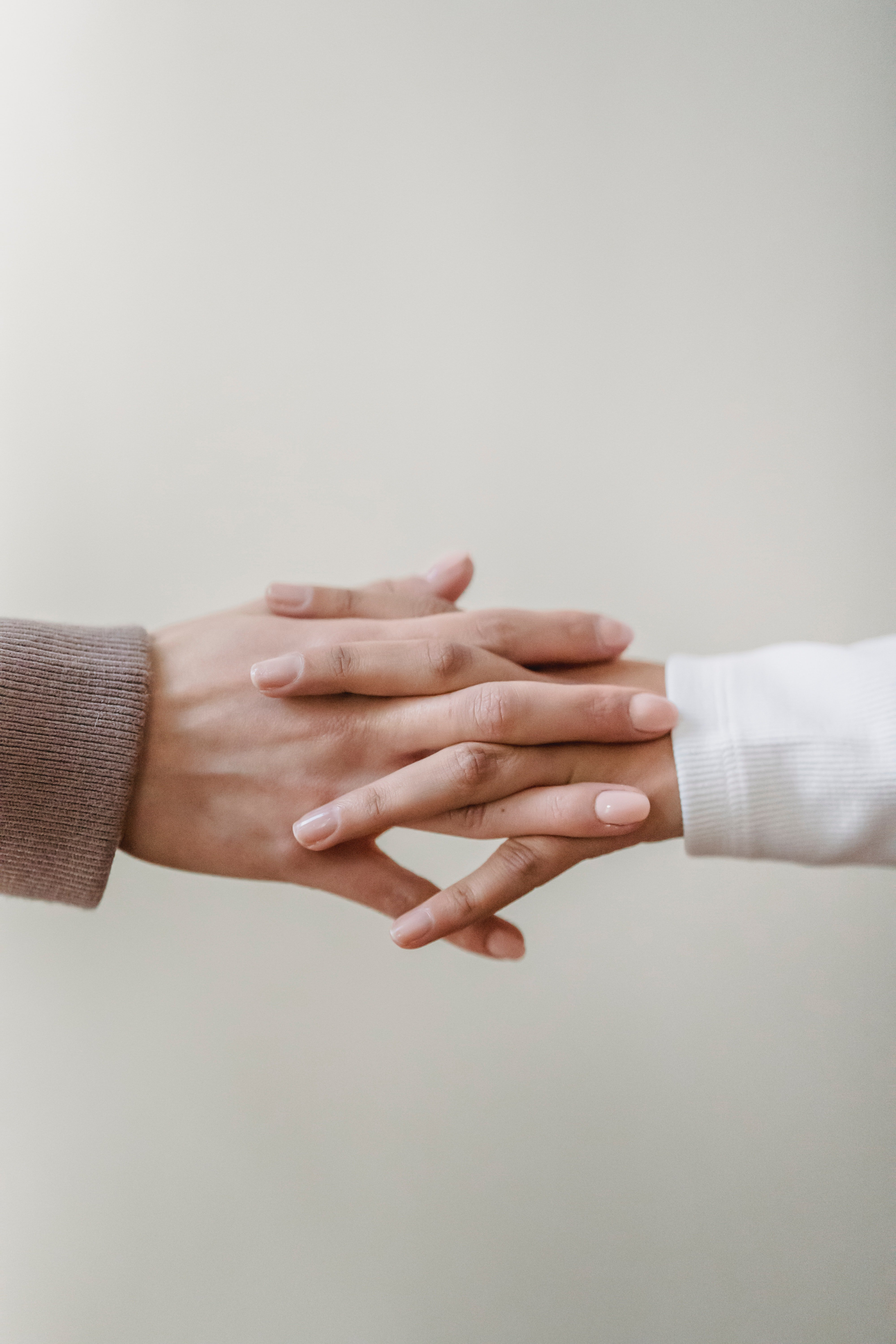 Two people with intertwined hands.   Photo: Pexels/Liza Summer