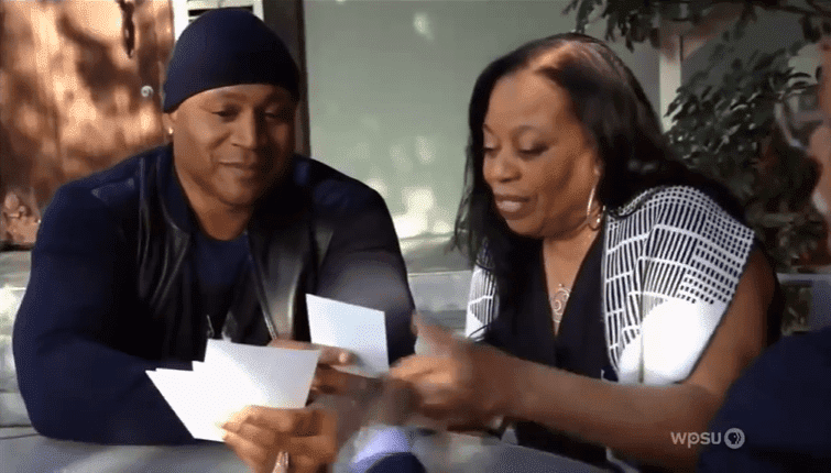 LL and his mother Ondrea watching pics of his newfound relatives. | Source: YouTube/Jorge Tindle
