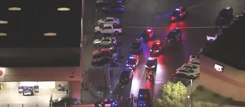 Police standing outside Costco | Photo: CBS Los Angeles
