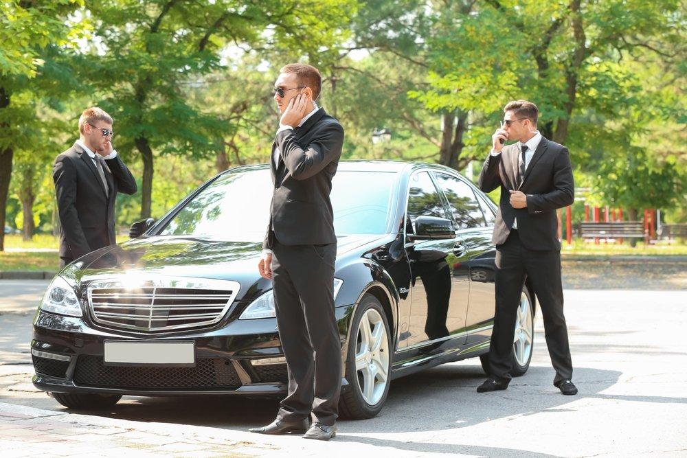 Bodyguards waiting patiently for their bosses to be done   Photo: Shutterstock