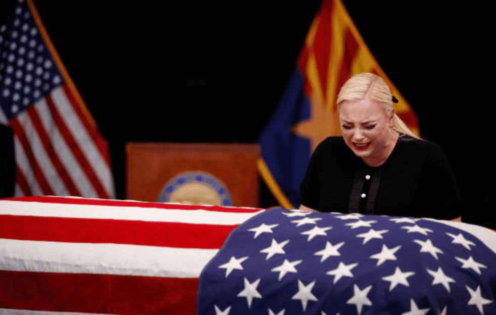 Meghan McCain, weeps over the casket of her father, Sen. John McCain, during a memorial service, on August 29, 2018, in Phoenix, Arizona | Source: Jae C. Hong - Pool/Getty Images