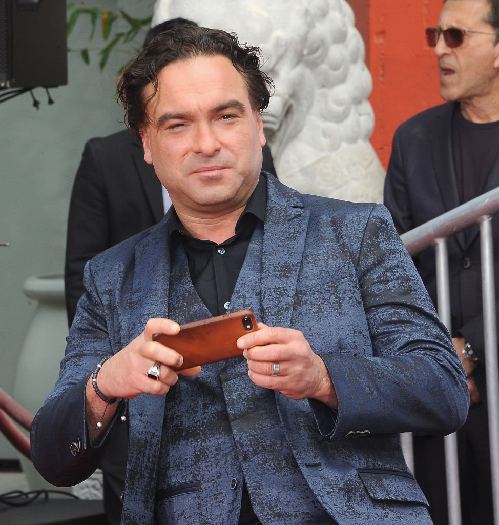 """Johnny Galecki takes photos after The Cast Of """"The Big Bang Theory"""" Handprints Cement Ceremony At The TCL Chinese Theatre IMAX Forecourt held 