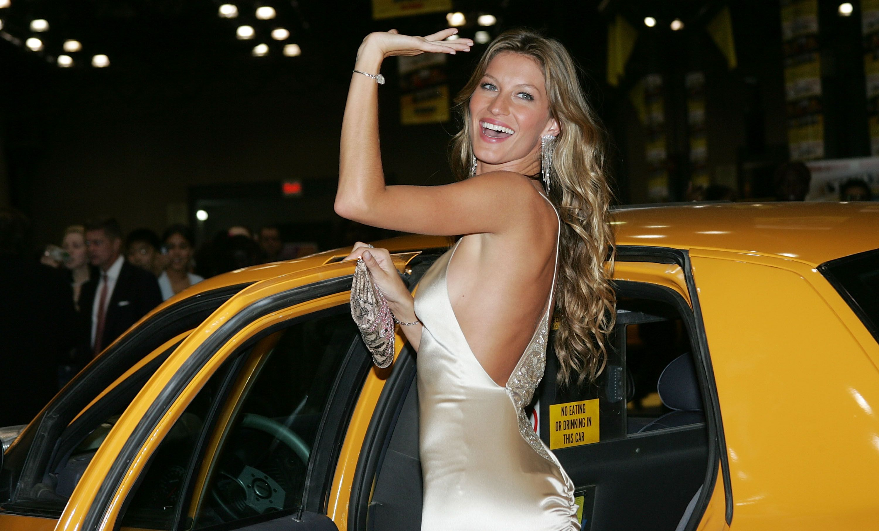 "Gisele Bundchen attends the ""Taxi"" film premiere, featuring a Taxi Cab Drive-In, at the Jacob Javits Center October 3, 2004 in New York City. 