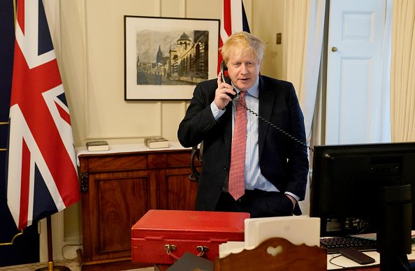 Prime Minister Boris Johnson on the telephone to Queen Elizabeth II for her Weekly Audience during the COVID-19 pandemic at 10 Downing Street on March 25, 2020 | Photo: Getty Images