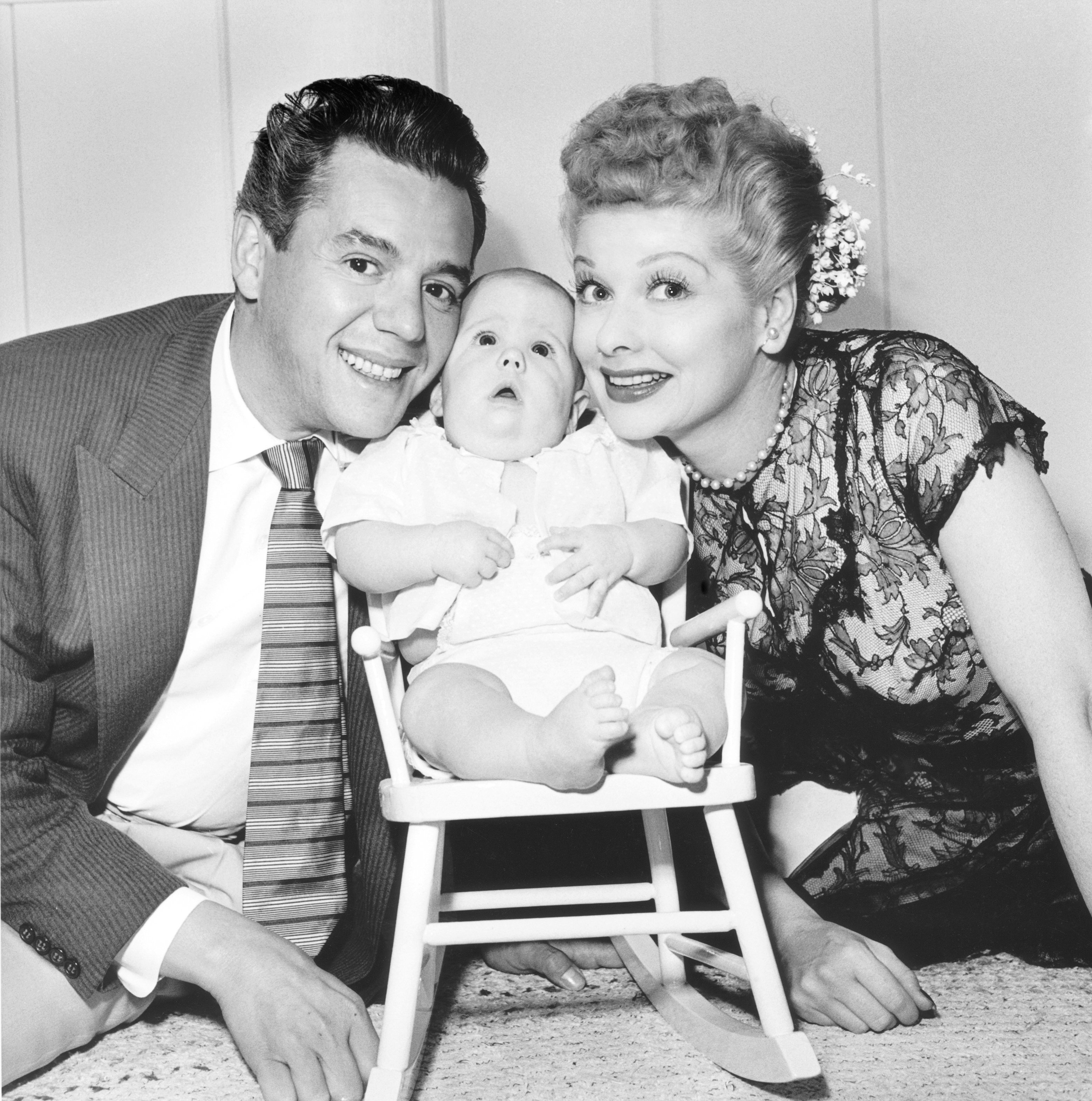Desi Arnaz and Lucille Ball with their son Desi Arnaz Jr. at their home in California in 1953 | Source: Getty Images