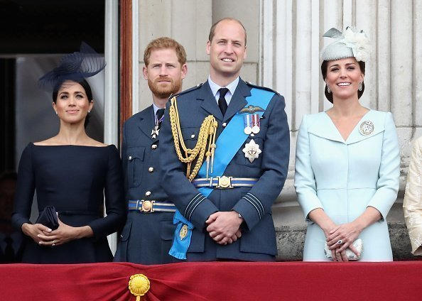 Meghan, Duchess of Sussex, Prince Harry, Duke of Sussex, Prince William, Duke of Cambridge and Catherine, Duchess of Cambridge watch the RAF flypast on the balcony of Buckingham Palace, as members of the Royal Family attend events to mark the centenary of the RAF on July 10, 2018, in London, England. | Source: Getty Images.