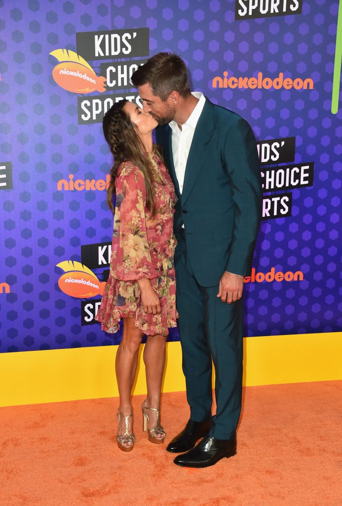 Danica Patrick (L) and NFL player Aaron Rodgers attend the Nickelodeon Kids' Choice Sports 2018 at Barker Hangar on July 19, 2018 in Santa Monica, California. | Source: Getty Images
