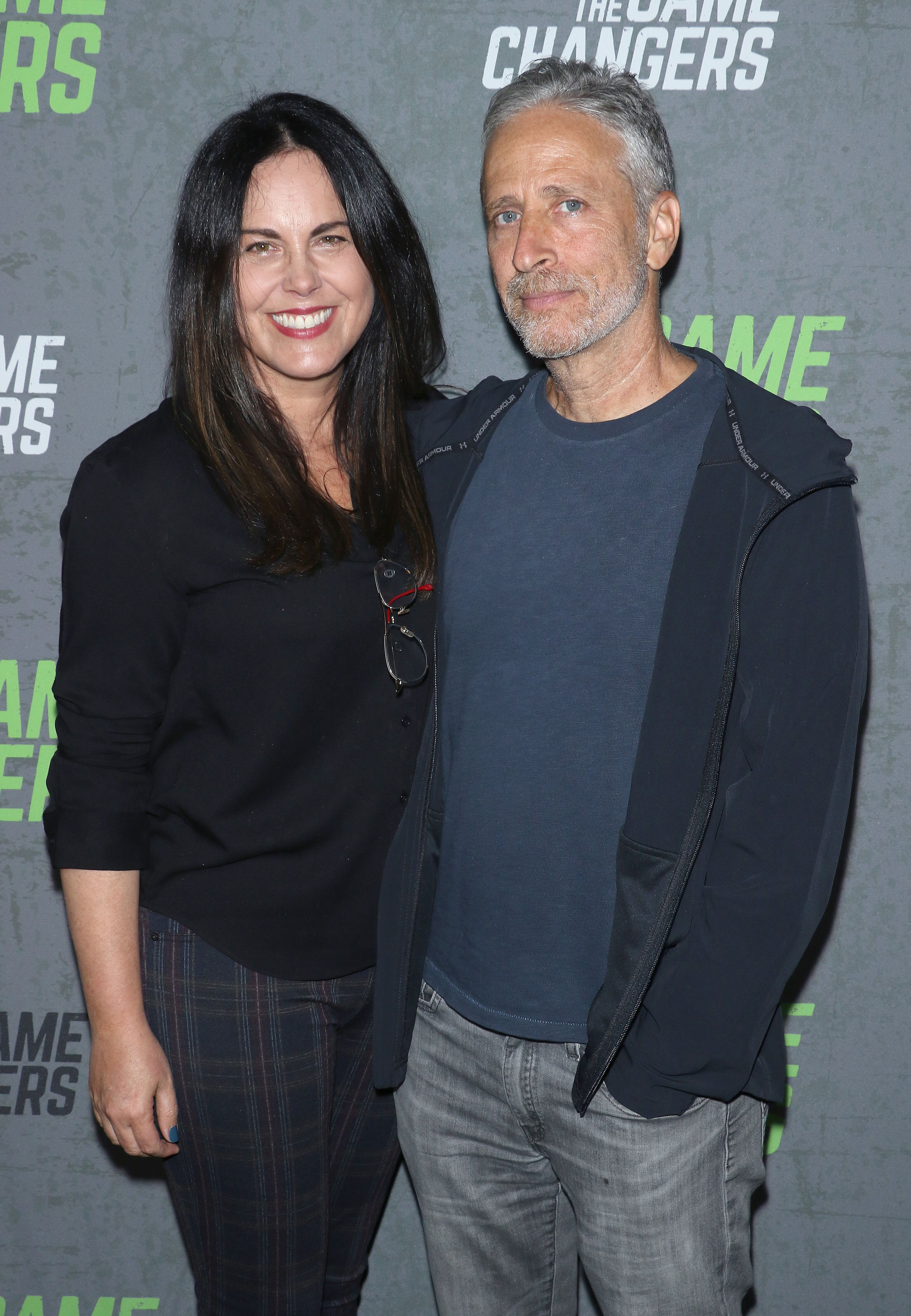 "Tracey McShane and comedian Jon Stewart attend the ""The Game Changers"" New York premiere. 