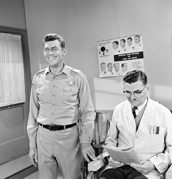"Andy Griffith as Sheriff Andy Taylor and Howard McNear as barber Floyd Lawson in a scene from the television series ""The Andy Griffith Show,"" circa 1966. 