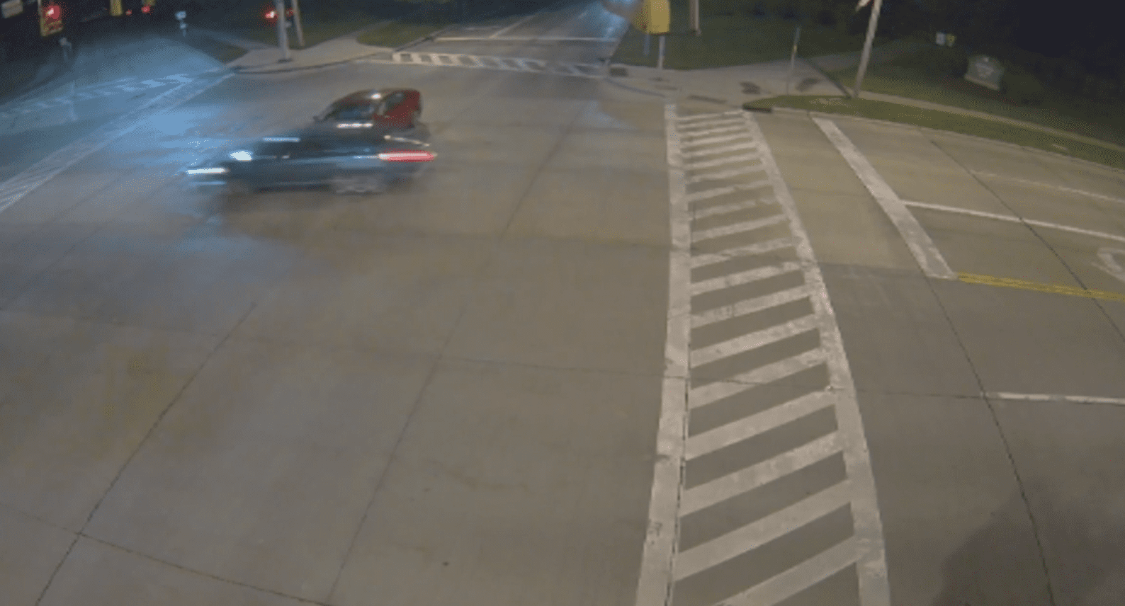 A traffic camera spots a woman speeding through a red light and crashing into a car   Photo: Youtube/FollowtheDominoes