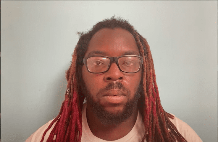 Brandon Presha's mugshot after getting arrested for illegal tattooing. | Source: Youtube/WSPA 7News