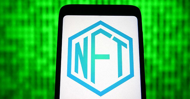 In this photo illustration a NFT sign is seen on a smartphone screen.   Source: Getty Images