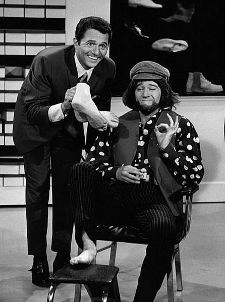 "George Carlin (right, in costume) and singer Buddy Greco (left) in a skit from the summer replacement television program ""Away We Go."" 