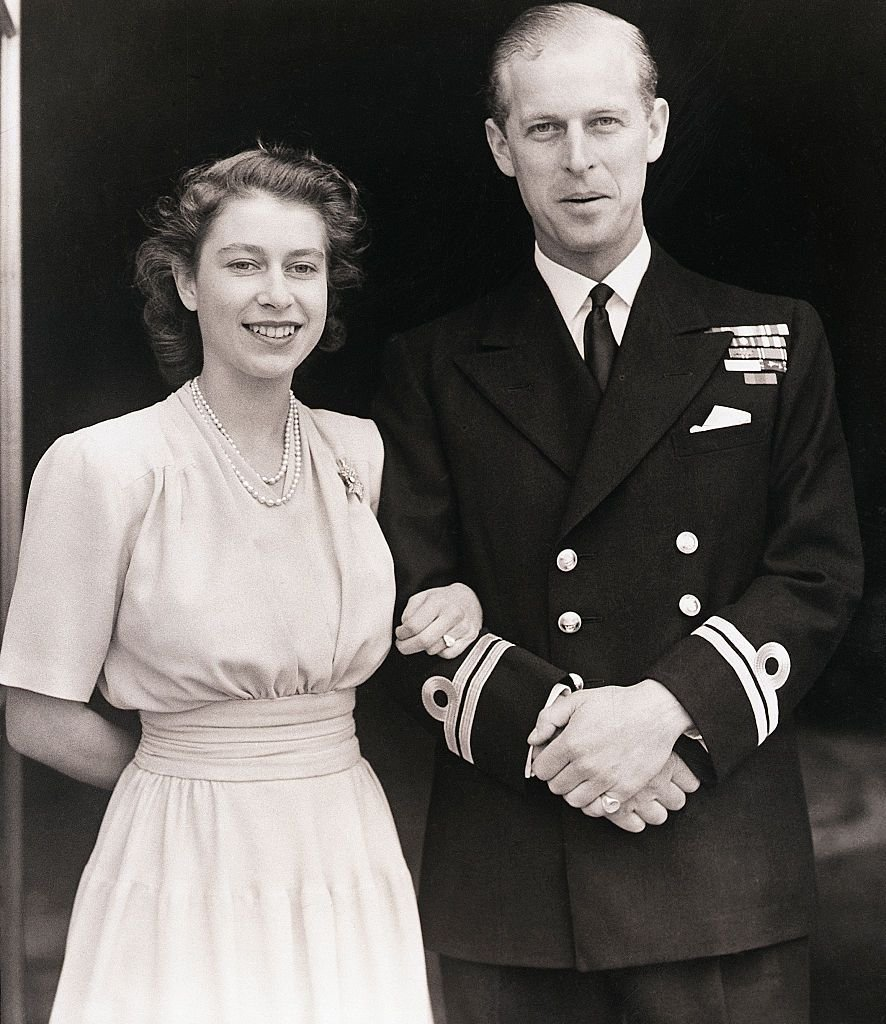 Princess Elizabeth and Lt. Philip Mountbatten at Buckingham Palace after the announcement of their betrothal in July 1947 | Source: Getty Images