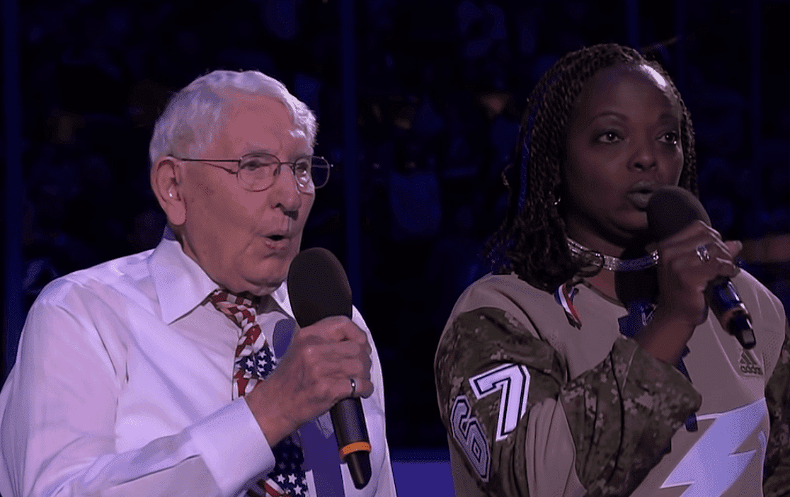 Retired veterans Sonya Bryson and Robert McClintock sing the national anthem as the Tampa Bay Lightning celebrate Military Appreciation Night at Amalie Arena. | Source: YouTube/NHL