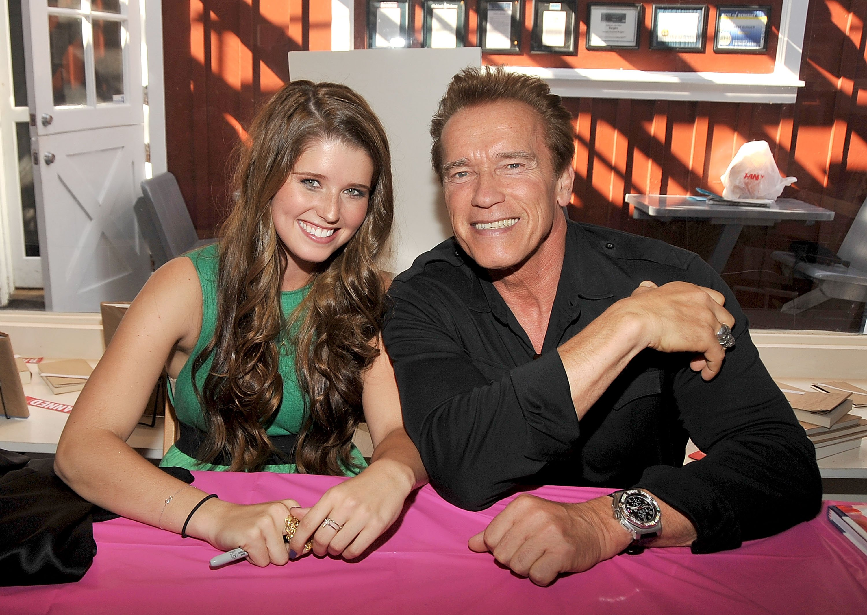 Katherine Schwarzenegger and father Arnold Schwarzenegger attend Katherine's book signing in Brentwood, California on October 2, 2010 | Photo: Getty Images