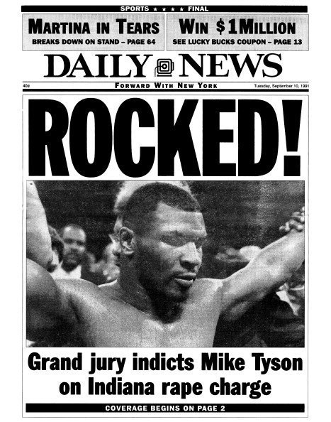 A daily news paper showing : ROCKED! Grand jury indicts Mike Tyson on Indiana rape charge.| Photo:Getty Images